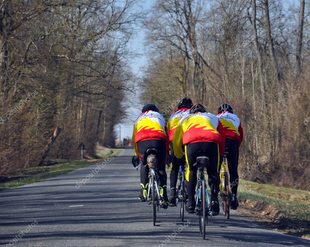 Road cyclists riding together on a roadway — Stock Photo #2579841