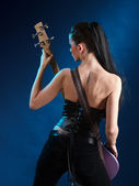 Girls with guitar from back — Stock Photo