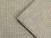 Gray knitted fabric — Stock Photo