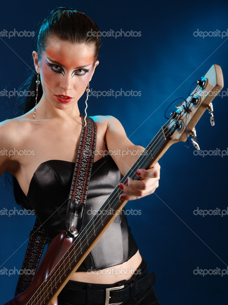 Girls with electric bass guitar in studio — Stock Photo #2152108