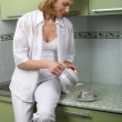 The girl pours coffee — Stock Photo