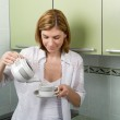 The girl pours coffee — Stock Photo #2185041