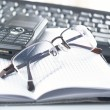 Royalty-Free Stock Photo: Notebook,glasses, keyboard