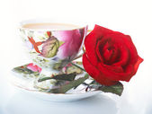 Rose and cup — Stock Photo