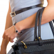 Bag on a female hand - Stock Photo