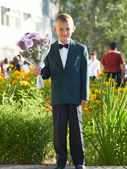 The boy with a bouquet of colors — Stock Photo