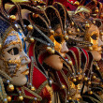 Row of venetian carneval masks — Stock Photo