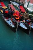 Gondolier and gondolas, Venice — Stock Photo