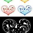 Royalty-Free Stock ベクターイメージ: Hearts with floral decorations