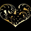 Gold ornate heart — Stock Vector