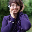 The smiling girl listens to music 3 — Stock Photo