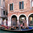 Stock Photo: One of channels to Venice and gondolas