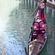 Gondola and the gondolier — Stock Photo