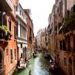 Stock Photo: One of channels to Venice and gondolas,