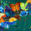 Stock Photo: Colour butterflies on gree background
