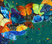 Colour butterflies on a gree background — Stock Photo