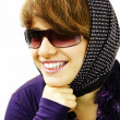 The smiling girl in sun glasses — Stock Photo