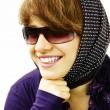 The smiling girl in sun glasses — Stock Photo