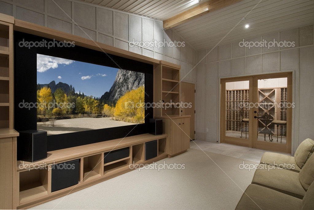 Home theater with wine tasting room, big screen, wood cabinets,photo on screen is one of my shots from yosemite — Stock Photo #2107710