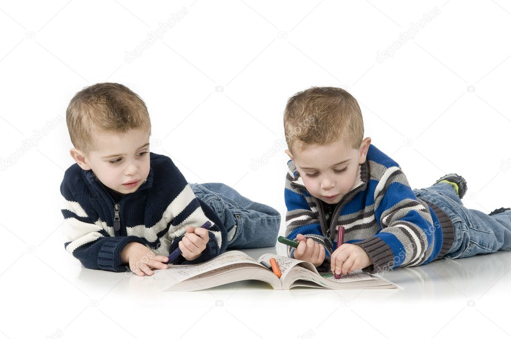 Three year old twin boys playing on white background, coloring in a book — Stock Photo #2206387