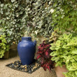 Garden fountain idea - Stock Photo