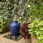 Garden fountain idea — Stock Photo