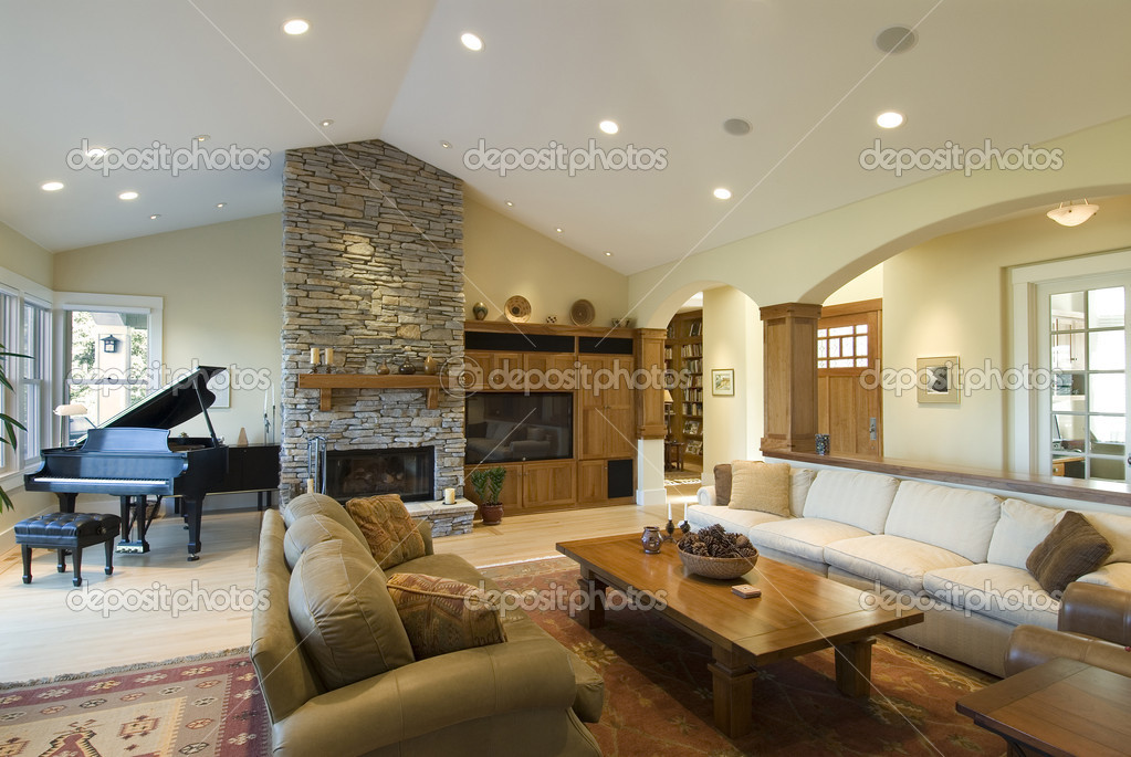 Living room in custom home,stone fireplace,grand piano,big screen,archways,contemporary furnishings — Photo #2236181