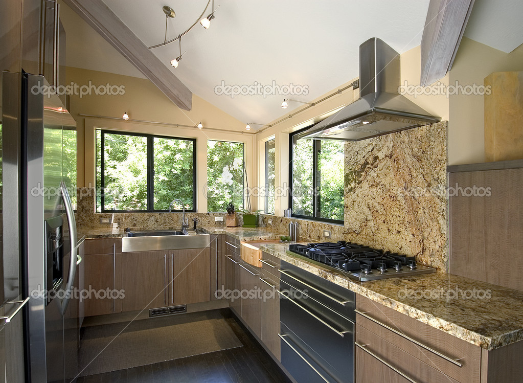 Modern kitchen with stainless appliances and granite countertops,track lighting — Stock Photo #2237063