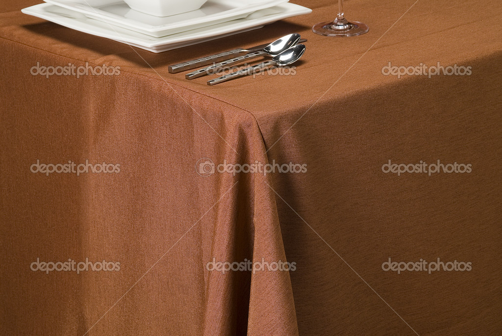 Table setting showing linen table cloth, dishes and silverware — Stock Photo #2237358