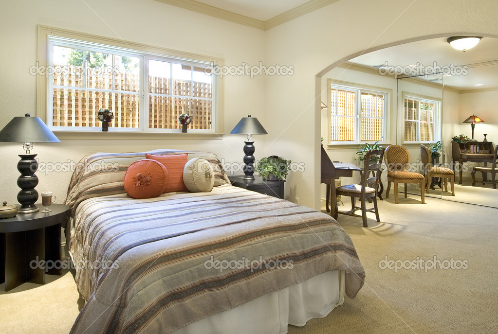 Bedroom interior,bed,tables,lamps,adjacent sitting room,closet mirror and small desk,windows — Stock Photo #2308011
