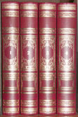 Four volume of the encyclopaedia in a red cover about gold letters — Stock Photo