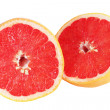 Grapefruit is cut on two parts — Stock Photo #2418962