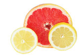 Grapefruit and lemon cut on a part — Stock Photo