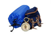 Backpack, sleeping bag and compass — Stock Photo
