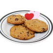 Plate of love and chocolate chip cookies — Stock Photo