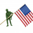Soldier carrying American flag - Stock Photo