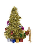 Placing presents under Christmas Tree — Stock Photo