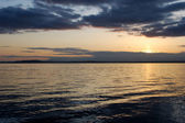 Sunset over the water — Stock Photo