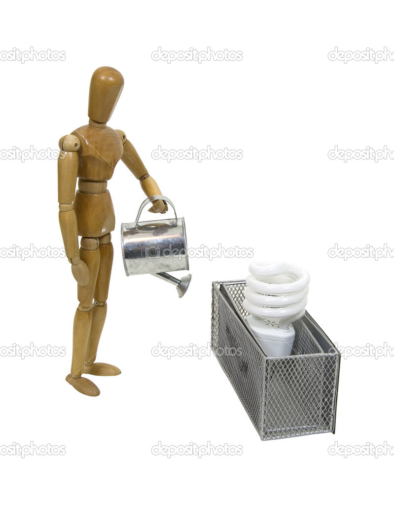 Cultivating efficient energy with a small metal watering can and a city box garden with spiral lightbulb - path included — Stock Photo #2130033