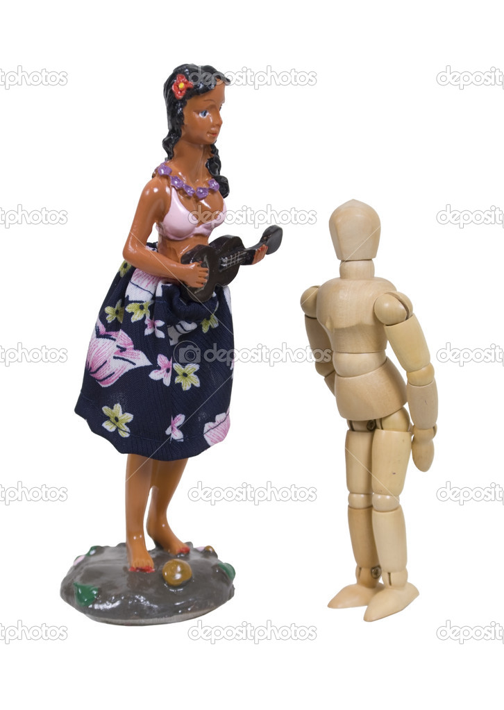 First crush shown by a model gazing at up at a Hawaiian Dancer with ukulele and floral skirt usually affixed to a car dashboard — Stock Photo #2130356