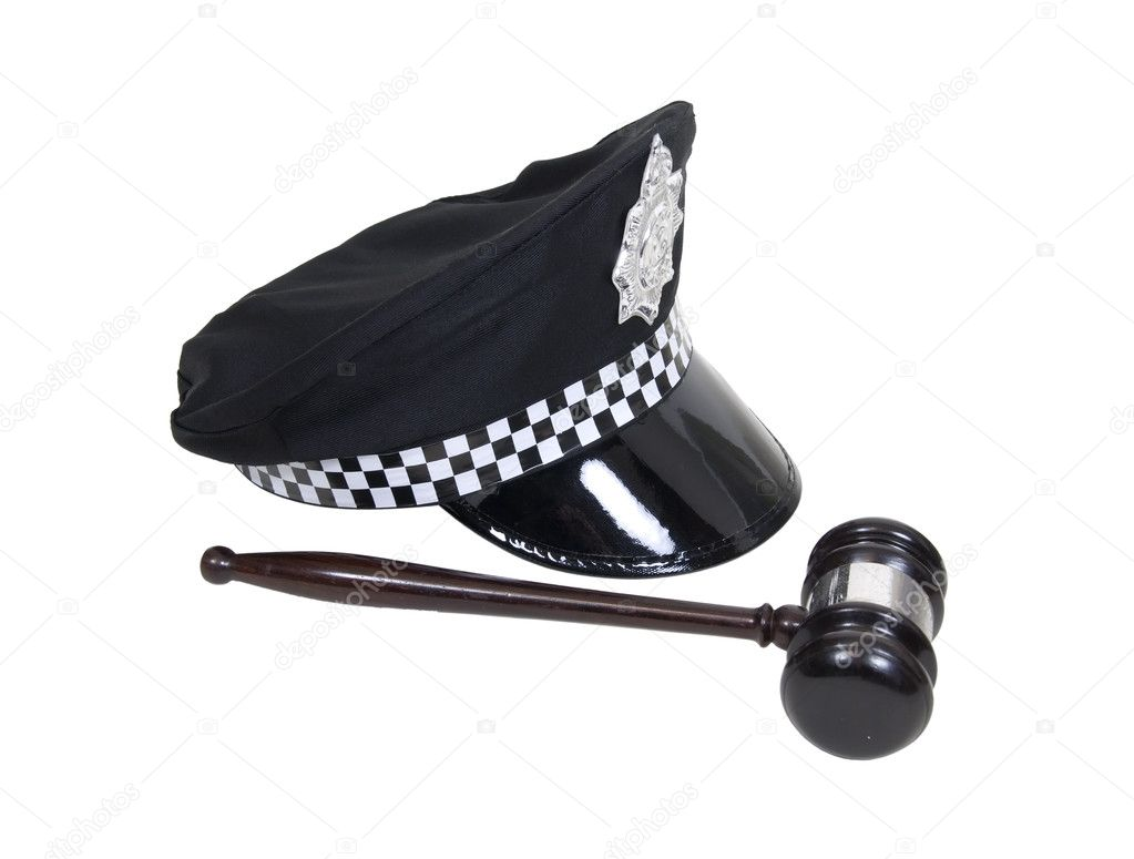 Law and order shown by a police hat with badge and a wooden gavel - path included — Stock Photo #2130971