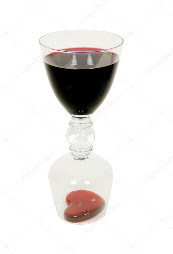 Dark red wine in a double drinking glass which holds a wine and brandy snifter at each end with red glass heart symbolizing love and romance — Stock Photo #2133262