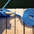 Stock Photo: Coiled Blue Rope and Cleat