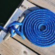 Coiled Blue Rope and Cleat — Stock Photo