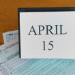 April 15 on calendar, 1040 tax forms — Stock Photo