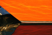 Reflection of Orange Sailboat Hull — Stock Photo