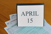 April 15 on calendar, 1040 tax forms — Stock Photo