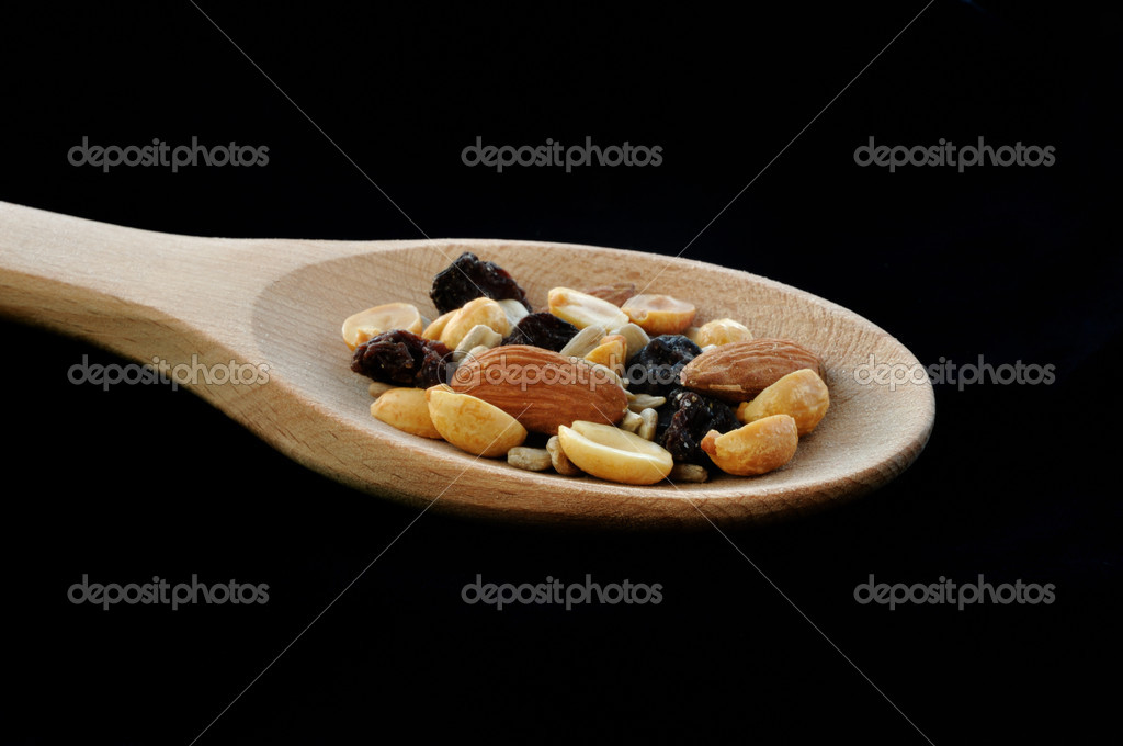 Trail Mix (Peanuts, Almonds, Sunflower Seeds, &  Raisins) on Wooden Spoon — Stock Photo #2160431