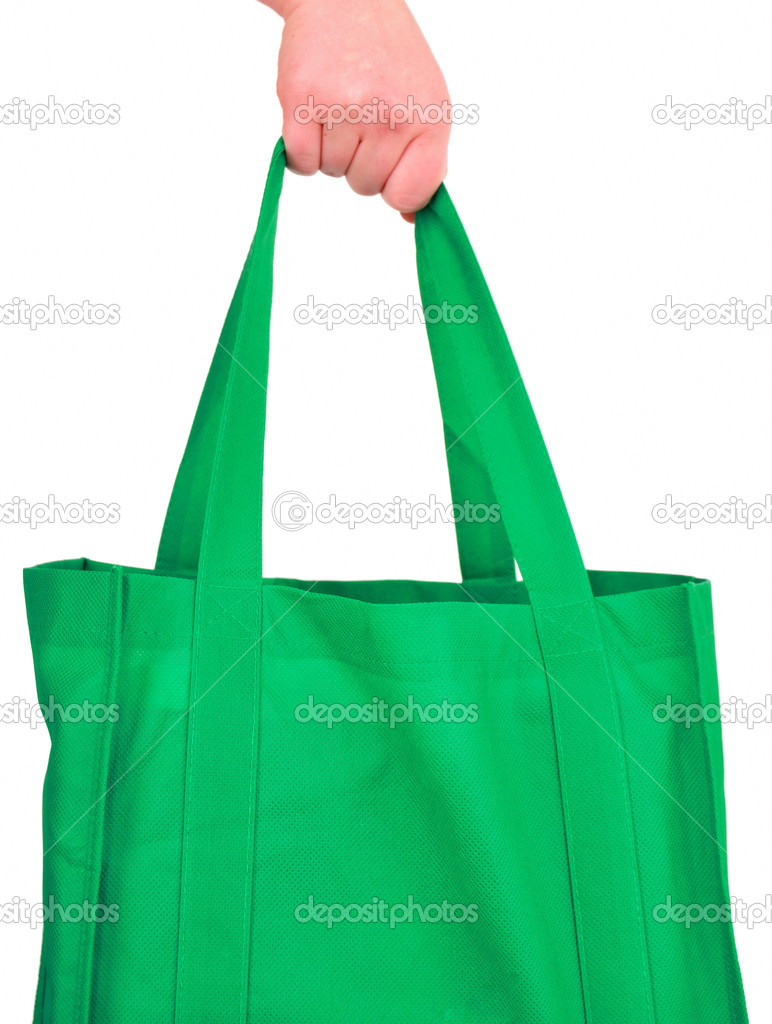 Carrying Reusable Green Bag Isolated on White — Stock Photo #2175749