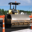 Steamroller at Road Construction Site - Stock Photo